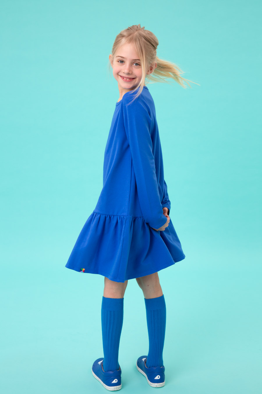 kids in colourful garments against colorful backgrounds with color props in a campaign for kids fashion brand My Basic